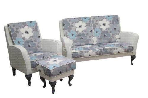 Tapicerowana stylowa sofa w kwiaty z fotelem i podnóżkiem